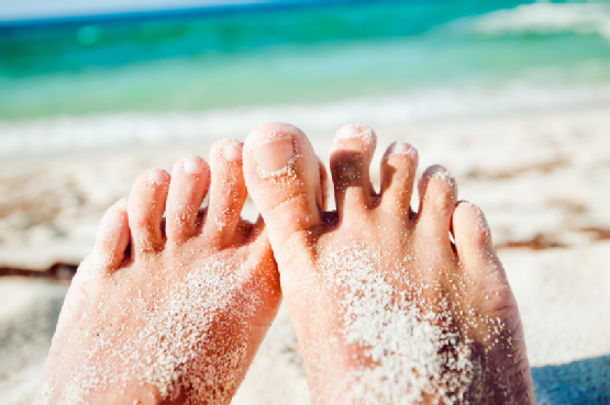 Fungal infections of the feet and toenails are more common in the summer because of the warmer temperatures.  You may experience heavier perspiration in your shoes.  If you are experiencing any of the following symptoms, you may be suffering from a fungal infection and should consult a physician:  Abnormal thickening of the toenail or it becomes distorted in shape. Toenail(s) become brittle or begin to crumble. A tiny yellowish-white spot beneath the toenail. Separation of the nail from the nail bed; a condition known as onycholysis. Red, inflamed, and/or itchy skin that may form oozing, crusty blisters. Foul odors from the toenails, between the toes, or from the feet generally. Beach The appearance and symptoms of a fungal infection can differ depending on the type and severity of the infection.  Some fungal infections may clear up on their own, but most will persist and progress if they are not treated by an experienced professional.  Treatment typically involves the administration of prescription anti-fungal medications to control the infection.  Unfortunately, fungal infections can easily recur if the feet are continuously exposed to the warm, dark, and moist conditions in which fungi thrive.  Practicing good foot hygiene on a daily basis can help to prevent initial infection and recurring infections.  Drying your feet well after washing, for example, can help to keep your feet free of fungus.  Wearing socks that take moisture away from the skin and nails can also help to keep your feet from becoming infected.  If you or a loved one is burdened with a fungal infection of the feet or toenails, consider seeking professional treatment at the Family Foot Center.  Our physician is experienced in providing patient-centered, personalized care to the Whitestone community and surrounding areas.  Call us today at (718) 767-5555 to schedule a consultation.